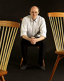 Photo of Chris with 3 chairs.